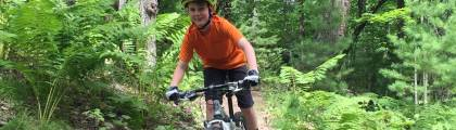 Boy biking Northwoods Zip Line Trail