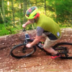 Riding a berm at the Zip Trail